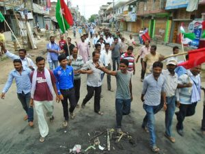 Caders of Madhesi Morcha forcing to shut down market areas in Rajbiraj, on the first day of  two day general strike on Sunday, August 16, 2015.  Photo: Byas Shankar Upadhyaya
