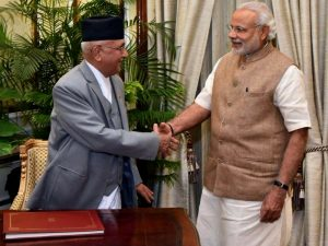 Prime Minister KP Sharma Oli shakes hands with his Indian counterpart Narendra Modi