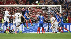 France's goalkeeper Hugo Lloris (4th L) catches the ball during the Euro 2016 group A football match between France and Albania at the Velodrome stadium in Marseille on June 15, 2016. / AFP PHOTO / BERTRAND LANGLOIS