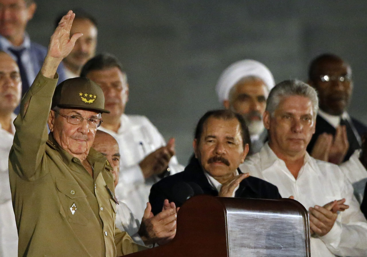 Cuba's President Raul Castro waves as he arrives to a rally honoring his deceased brother Fidel Castro at the Revolution Plaza in Havana, Cuba, Tuesday, Nov. 29, 2016. Schools and government offices were closed Tuesday for a second day of homage to Fidel Castro, with the day ending in a rally on the wide plaza where the Cuban leader delivered fiery speeches to mammoth crowds in the years after he seized power. Fidel Castro passed away Friday Nov. 25. He was 90. First from right Cuba's First Vice President Miguel Diaz-Canel, at center Nicaragua's President Daniel Ortega. (AP Photo/Ricardo Mazalan)